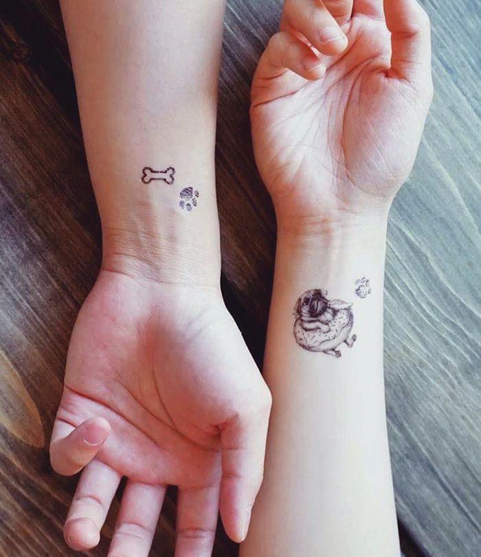 Собаки на татуировке